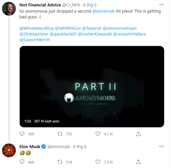 Elon Musk laughs while watching a video impersonating Anonymous.